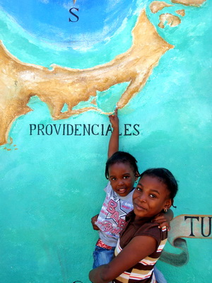Our shopping trip was pleasantly interrupted by two beautiful little girls who posed for me by the great mural at Ports of Call