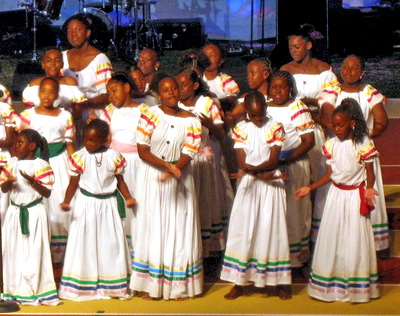 These young people perform folk songs in their national dress of white cotton with coloured bands representing each island.