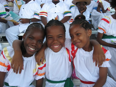 Sweet smiling island girls in their national dress