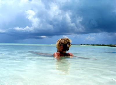 Here's Eva in the shallow waters off Osprey Rock with ominous black clouds rolling in