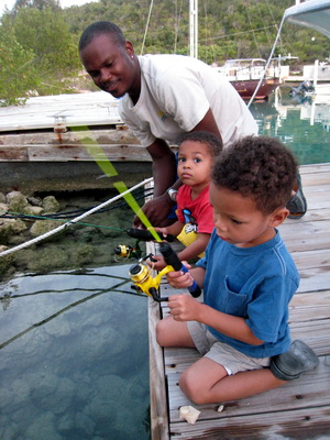 Wayne and his kids fishing off the docks at Harbour Club Villas