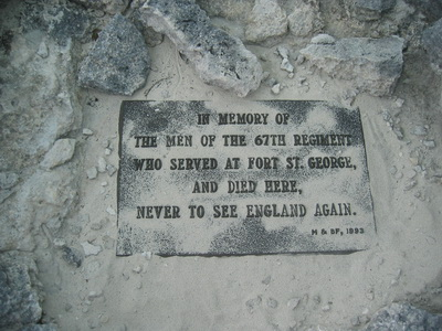 A marker lies buried in the sand on Ft St George Cay