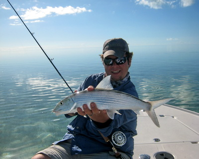 Joe got busy and caught his first bonefish of the day.........a beauty!