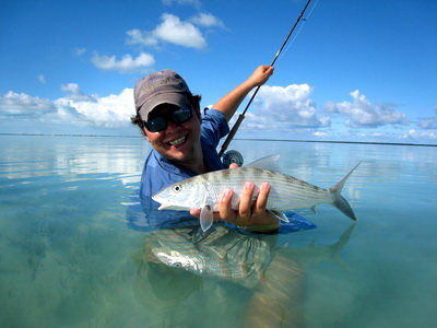 "Joe smiles from ear to ear.......another bonefish. They're called ""the ghosts of the flats"""