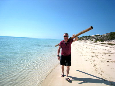 Mike carries home the bamboo I found on the beach