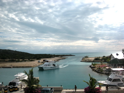 Caicos Adventures catamaran dive boat heads into our marina after a spectacular dive day. Remember that it's whale watching time in the Turks and Caicos Islands.