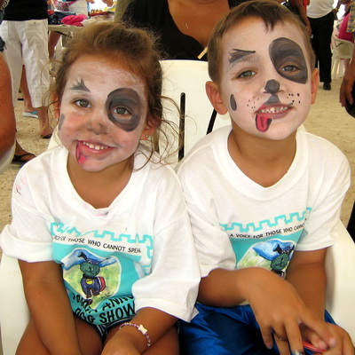 I wish they'd get the show started as these doggy face painted youngsters wait patiently