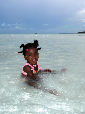 This pretty little miss was having a blast playing in the water.