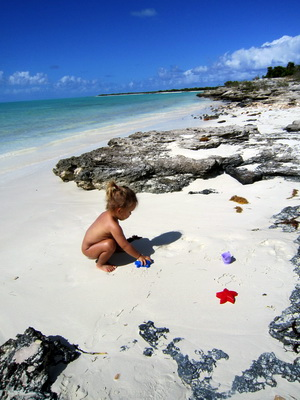 Malaika was entranced by making prints in the sand with her toys.