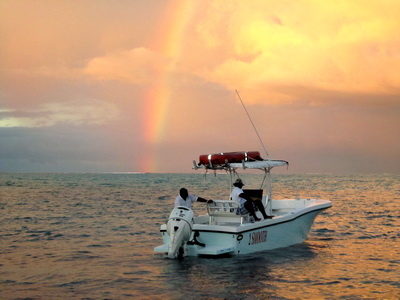 Mother nature treated us to a wondrous rainbow sunset..the sky was a blaze of orange and pink with a beautiful rainbow to top it all off.