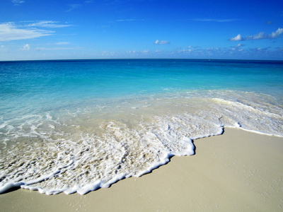Grace Bay beach is breathtaking.......the colours.....golden sand, frothy white waves, turquoise and dark blue and the bluest of skies with a few white puff ball clouds.