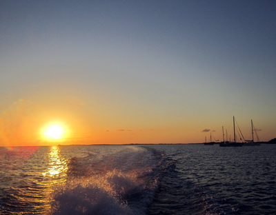A parting shot of the sunset and Sapodilla Bay boats as we motored home to Harbour Club's Marina