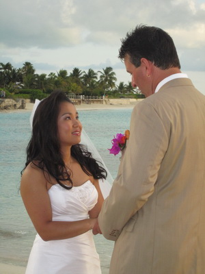 A moment to cherish as the bride and groom exchange vows as the sun slowly slipped into the ocean