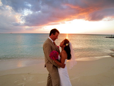 The pink and golden rays of the setting sun made for an awesome photo of the bride and groom.