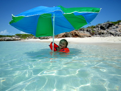 Malaika had great fun playing under the umbrella as the tide came in.