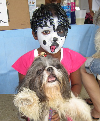 """Doggie"" face painting was a big hit with the kids."
